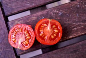 Tomato in two halves with seeds